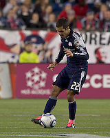 New England Revolution midfielder Benny Feilhaber (22) passes the ball.  In a Major League Soccer (MLS) match, the Columbus Crew defeated the New England Revolution, 3-0, at Gillette Stadium on October 15, 2011.z
