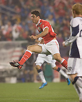 SL Benfica midfielder Filipe Menezes (24) follows through on scoring shot. First goal of the game for SL Benfica. SL Benfica  defeated New England Revolution, 4-0, at Gillette Stadium on May 19, 2010.