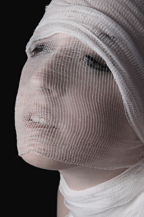 A young woman with her head wrapped in gauze