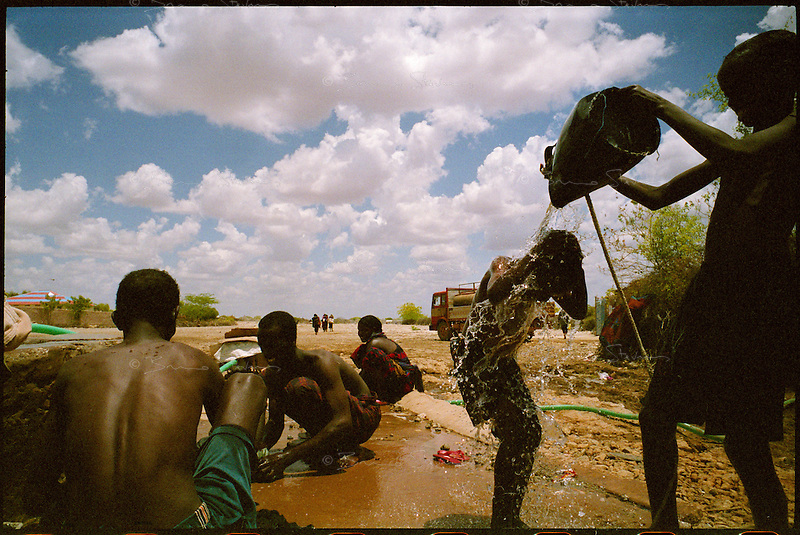 Wajid, Somalia, March 2006.Boys wash near a water well in Wajid.
