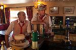 Morris men in Essex village pub. Decorated with union jack english Uk flags.