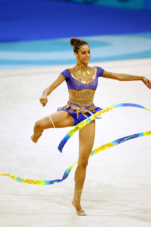 Almudena Cid of Spain fouette with ribbon at 2004 Athens Olympic Games during qualifications on August 27, 2006 at Athens, Greece. (Photo by Tom Theobald)