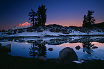 Sunrise reflected in a lake near Austin Pass in the Mount Baker Wilderness, Washington.