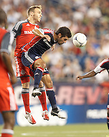 New England Revolution forward Benny Feilhaber (22) heads the ball. In a Major League Soccer (MLS) match, Toronto FC defeated New England Revolution, 1-0, at Gillette Stadium on July 14, 2012.
