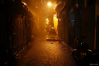 Heavy rain pours as the body of Romeo Joel Fontanilla is left in a narrow alley in Manila, Philippines early October 11, 2016. Romeo Joel Fontanilla, who was, according to the police, a known drug user and pusher was shot dead by three motorcycle riding gunmen. REUTERS/Damir Sagolj