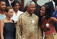 Nelson Mandela flanked by supermodels Kate Moss (left) and Naomi Campbell (right) at a charity event at the presidential guesthouse in Cape Town. Moss is alleged to have snorted cocaine just prior to greeting Mandela.