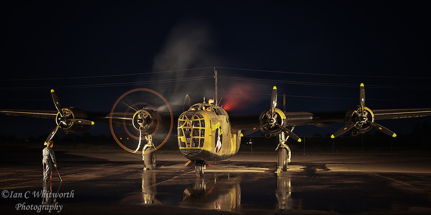 Starting the engines at night of the B-24 Liberator heavy bomber at the Canadian Warplane Heritage Museum in Hamilton.