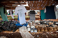 Used shirts and shoes for sale in Iten. City market scene in Iten, Kenya. This small city has been a training ground of athletic champions for years. Today the tradition continues despite a drop in sponsorship for international races...