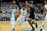 14 February 2016: North Carolina's Joel Berry II (2) and Pittsburgh's Chris Jones (12). The University of North Carolina Tar Heels hosted the University of Pittsburgh Panthers at the Dean E. Smith Center in Chapel Hill, North Carolina in a 2015-16 NCAA Division I Men's Basketball game. UNC won the game 85-64.