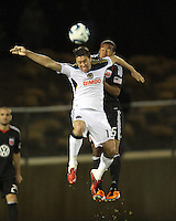 Ethan White(15) of D.C. United  goes for a header against Kyle Nakazawa(13)of the Philadelphia Union during a play-in game for the US Open Cup tournament at Maryland Sportsplex, in Boyds, Maryland on April 6 2011. D.C. United won 3-2 after overtime penalty kicks.