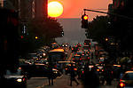 The sun sets down 34th Street in Manhattan 5/28/06. Robert Caplin For The New York Times