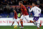 Calcio, Serie A: Roma vs Fiorentina. Roma, stadio Olimpico, 8 dicembre 2012..AS Roma midfielder Daniele De Rossi is chased by Fiorentina forward Mounir El Hamdaoui, of Morocco, right, during the Italian Serie A football match between AS Roma and Fiorentina at Rome's Olympic stadium, 8 december 2012..UPDATE IMAGES PRESS/Isabella Bonotto
