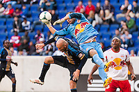 New York Red Bulls goalkeeper Luis Robles (31) goes over the top of Conor Casey (6) of the Philadelphia Union during the second half. The New York Red Bulls defeated the Philadelphia Union 2-1 during a Major League Soccer (MLS) match at Red Bull Arena in Harrison, NJ, on March 30, 2013.