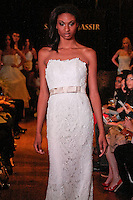 Model walks the runway in a Grace wedding dress - cotton crochet lace gown over silk organza with solk taffeta sash, by Sarah Jassir, for the Sarah Jassir Couture Bridal Fall 2012 Opulence collection.