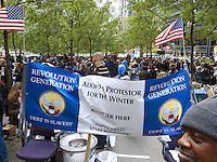USA. New York City. Occupy Wall Street (OWS) is a people-powered movement that began on September 17, 2011 in Liberty Square in the Wall Street financial district of Manhattan. The protesters have created a small campsite at the Zuccotti Park site. OWS and has spread to over 100 cities in the United States and actions in over 1,500 cities globally. OWS is mainly protesting social and economic inequality, corporate greed, corruption and influence over government&mdash;particularly from the financial services sector&mdash;and lobbyists.  It is fighting back against the corrosive power of major banks and multinational corporations over the democratic process, and the role of Wall Street in creating an economic collapse that has caused the greatest recession in generations. The protesters' slogan, &quot;We are the 99%&quot;, refers to the difference in wealth and income growth in the U.S. between the wealthiest 1% and the rest of the population. OWS aims to expose how the richest 1% of people are writing the rules of an unfair global economy that is foreclosing on our future. OWS has being organized using a non-binding consensus based collective decision making tool known as a &quot;people's assembly&quot;. Afro-american man and two american flags. 20.10.2011 &copy; 2011 Didier Ruef