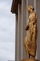 """PARIS, FRANCE -  APRIL 27 : A low angle view of """"La Campagne"""" on 27 April 2008, at the Palais de Chaillot in the 16th arrondissement of Paris, France. The gilded bronze sculpture of a standing woman, an allegory of the countryside, adorns the facade of the Art Deco Palais de Chaillot, built in 1937 for the International Exhibition since the inauguration of the building. It was created by Paul Cornet, 1892-1977, a figurative sculptor who worked from nature producing many sensitive portraits of women. La Campagne is seen here on a late spring afternoon. (Photo by Manuel Cohen)"""
