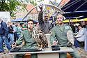 "Cast members, Lewis Howard (as Callum), Alan Munden, and  Ben Dyson (as Paddy) from ""Swivelhead"", Pipeline Theatre's new play, meet a barn owl and an eagle owl in the courtyard at the Pleasance. ""Swivelhead"" runs from 3rd - 29th August in Pleasance 2."