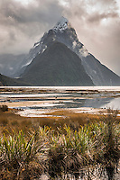 Milford Sound with Mitre Peak with dramatic skies before sunset, Fiordland National Park, Southland, World Heritage Area, New Zealand