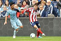 Chivas Jorge Villafana (19) midfield USA watched by Paulo Nagamura  (6) midfield Sporting KC..Sporting Kansas City defeated Chivas USA 4-0 at Sporting Park, Kansas City, Kansas.