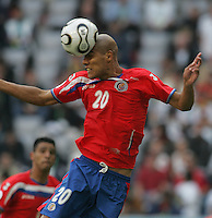 JUNE 9, 2006: Munich, Germany: Costa Rican midfielder (20) heads the ball out of the box while playing Germany in the World Cup Finals in Munich, Germany. Germany defeated Costa Rica, 4-2.