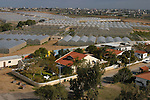 Houses and greenhouses of the Israeli settlement of Morag, neighboring the Palestinian town of Khan Yunes, at the Gush Katif settlement bloc in Gaza Strip.