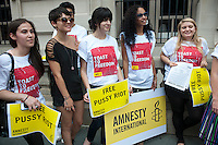 Members of Amnesty International, joined by activist lawyer Norman Siegel, stand near the Russian Consulate in New York on Friday, July 27, 2012 calling for the release from excessive detention of three members of the female Russian punk band Pussy Riot. Nadezhda Tolokonnikova, Maria Alekhina and Yekaterina Samutsevich.  members of the band have been held in pre-trial detention since March of this year after protesting against Russian President Putin via an unauthorized performance in the Christ the Saviour Cathedral in Moscow. They face up to seven years in jail on hooliganism charges. . (© Richard B. Levine)