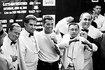 ARTURO GATTI (2/12) --&nbsp;Boxer Arturo Gatti (center) poses with waiters at Gallagher's Steakhouse in Manhattan after a news conference to promote his June 25 super lightweight championship fight against Floyd Mayweather, Jr. in Altantic City.   NEW YORK CITY, NY  3/24/05  2:55:32 PM  .