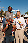 Bellmore, New York, USA. September 20, 2015. R-L, U.S. Senator CHARLES (CHUCK) SCHUMER (Democrat - New York), poses for a photo with KAYLA ANDERSON, 8, and her father NORBERT ANDERSON, of Baldwin, who is holding his daughter's legs as she sits on his shoulders, at the 29th Annual Bellmore Family Street Festival, featuring family fun with exhibits and attractions, with over 100,000 people expected to attend over the weekend. The popular Nassau County fair is made possible by volunteers from the Chamber of Commerce of the Bellmores, the event host.