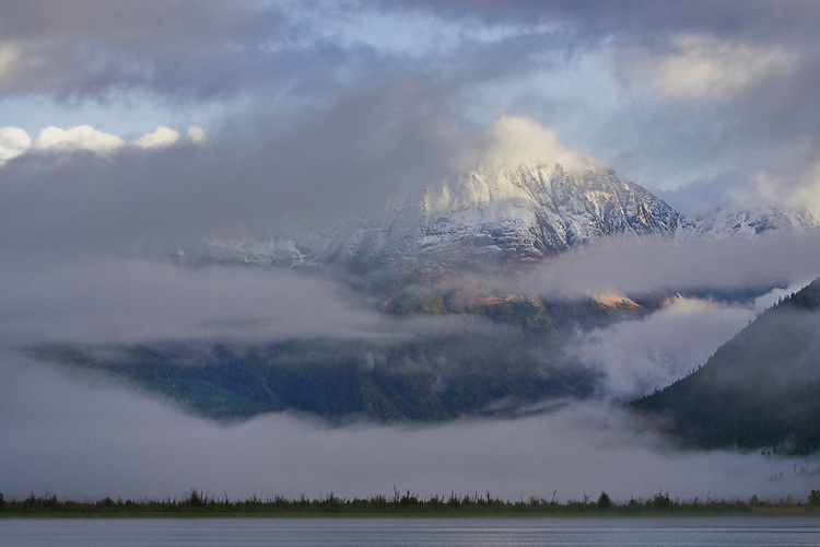 Early morning mist partially obscurring a mountain at the head of the Mitchell River