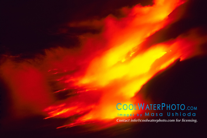 lava ocean entry - new land are violently created by countless hydromagnetic explosions as hot molten lava flows into the Pacific Ocean, Hawaii Volcanoes National Park at night, Kilauea, Big Island, Hawaii, USA