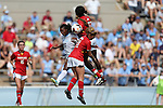 06 October 2013: North Carolina's Crystal Dunn (19) challnges for a header with Maryland's Shade Pratt (22) and Lauren Berman (11). The University of North Carolina Tar Heels hosted the University of Maryland Terrapins at Fetzer Field in Chapel Hill, NC in a 2013 NCAA Division I Women's Soccer match. UNC won the game 3-1.