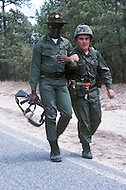 Fort Dix, NJ, USA, June 1980. US Army military training. Groups of recruits march in column for several miles every day under the supervision of their instructors. Some of the fresh soldiers sometimes need extra help to keep up with the group.