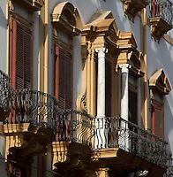 Baroque facades of buildings with balconies in Via Alloro, Palermo, Sicily, Italy. Picture by Manuel Cohen