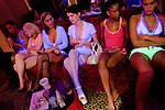 Sex workers, from left, Nina Nicole, Rhiannon, Erin Daye, Mila Moore, Kitten, and Skye High sit in the parlor of the Moonlite Bunny Ranch brothel in Mound House, NV on Friday, July 28, 2006...The Moonlite Bunny Ranch brothel in Mound House, Nevada - just a few miles from the state capital in Carson City - first opened in 1955. The Ranch is a legal, licensed brothel owned by Dennis Hof. It's featured in the HBO series &quot;Cathouse.&quot;