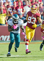 Philadelphia Eagles running back Wendell Smallwood (28) carries the ball late in the third quarter against the Washington Redskins at FedEx Field in Landover, Maryland on Sunday, October 16, 2016.  in pursuit is Washington Redskins defensive end Trent Murphy (93).<br /> The Redskins won the game 27 - 20.<br /> Credit: Ron Sachs / CNP /MediaPunch