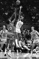 Golden State Warrior Charles Johnson #10 shoots over Chicago Bulls Love..(1973 photo/Ron Riesterer)