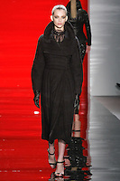 Aline walks runway in a ebony trapunto-switched felted wool coat over ebony silk chiffon and lace embroidered blouse, from the Reem Acra Fall 2012 Feminine Power collection fashion show, during Mercedes-Benz Fashion Week New York Fall 2012 at Lincoln Center.