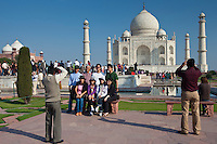 Tourists taking photographs at The Taj Mahal mausoleum southern view Uttar Pradesh, India