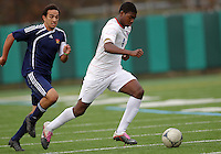 HYATTSVILLE, MD - OCTOBER 26, 2012:  Wesley Snuggs (4) of DeMatha Catholic High School races away from Michael Sniezek (3) of St. Albans during a match at Heurich Field in Hyattsville, MD. on October 26. DeMatha won 2-0.