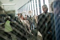A tour group reflected in a window at Central Prison in Raleigh, NC on Thursday, November 17, 2016. (Justin Cook)