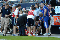 FC Dallas midfielder Ricardo Villar is treated on the sidelines by the medical staff... Sporting KC defeated FC Dallas 2-1 at LIVESTRONG Sporting Park, Kansas City, Kansas.