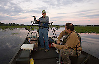 Guide Ron Russell, Gator Getter Consutants, demonstrates where hunter Jeff Bannister, of Greenville, will have to shoot a cross bow to hit the alligator during their alligator hunt along the Cooper River Oct. 5, 2008 in Moncks Corner, South Carolina. (Paul Zoeller/pressphotointl.com)