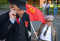RUSSIA - Russland - MOSCOW, MOSKAU - Platz der Revolution: Schauspieler als LENIN mit Handy;. Revolution Square, actor as LENIN with mobile phone & Brezhnev  with Soviet flag
