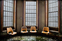 Four plastic chairs by windows