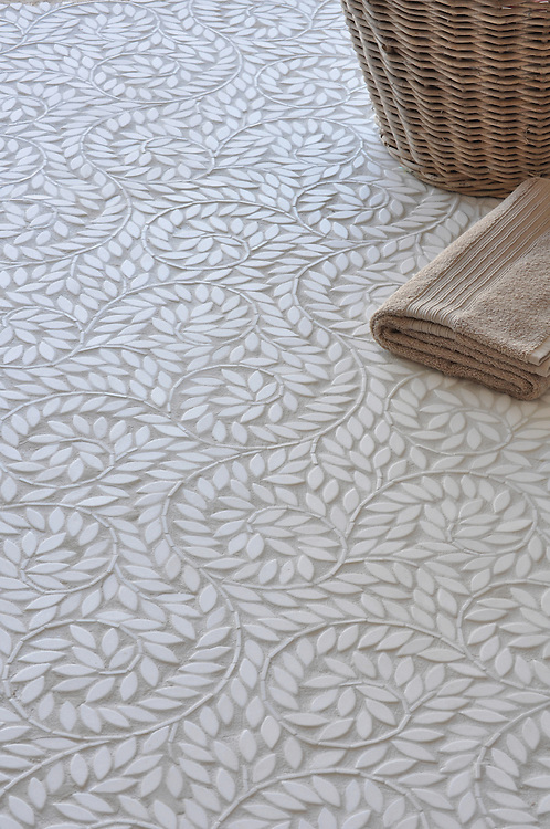 Jacqueline Vine, a natural stone waterjet mosaic, is shown in tumbled Thassos.