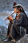 00423_04, Pakistan, PAKISTAN-10044, 1981. A woman plays the flute in Pakistan. <br />