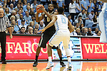 20 January 2016: Wake Forest's Codi Miller-McIntyre (left) and North Carolina's Nate Britt (right). The University of North Carolina Tar Heels hosted the Wake Forest University Demon Deacons at the Dean E. Smith Center in Chapel Hill, North Carolina in a 2015-16 NCAA Division I Men's Basketball game. UNC won the game 83-68.