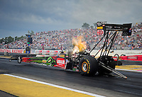 Aug. 19, 2011; Brainerd, MN, USA: NHRA top fuel dragster driver Terry McMillen during qualifying for the Lucas Oil Nationals at Brainerd International Raceway. Mandatory Credit: Mark J. Rebilas-
