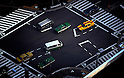 Shot from the 54th floor of the Mori Tower in Tokyo's fashionable Roppongi Hills, taxis take on a toy car feel as they line up on a junction below.