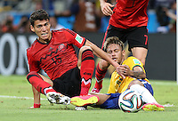 Brazil's Neymar and Mexico's Hector Moreno clash